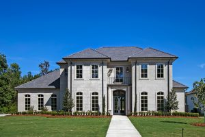 This French Provincial home is a 2-story custom built home that is located close to New Orleans.